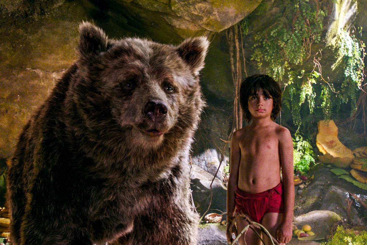 Mowgli and Palo Bear in a photo from the movie