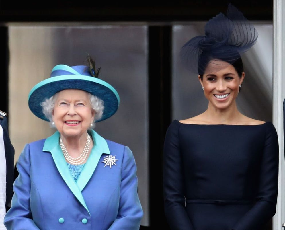 London, England - 10 July: Queen Elizabeth II and Meghan, Duchess of Sussex, watch the RAF air force on the balcony of Buckingham Palace, as members of the royal family attend events to celebrate the RAF centenary on July 10, 2018 in London, England .  (Photo by Chris Jackson / Getty Images)