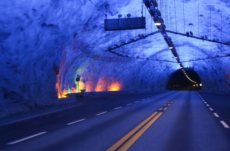 Not the light in the end, but the colorful lights inside the Lærdal Tunnel make the trek a great experience.