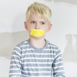 New Zealand: Teacher pastes mouths of children in class