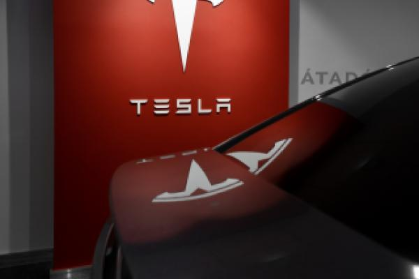 """Tesla finally got a """"superior"""" rating from its Wedbush long-term bull, with a higher price target"""