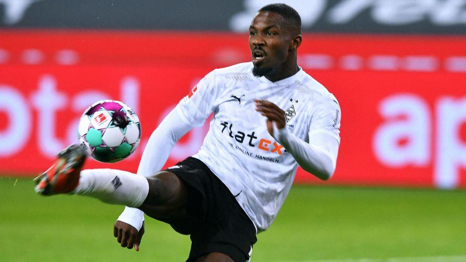 Gladbach striker Marcus Thuram foules the ball