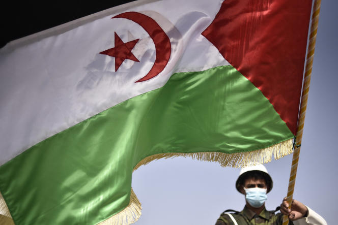 A Polisario fighter waves the Sahrawi flag during the celebration of the 45th anniversary of the declaration of the SADR, in Tindouf, Algeria, on February 27, 2021.