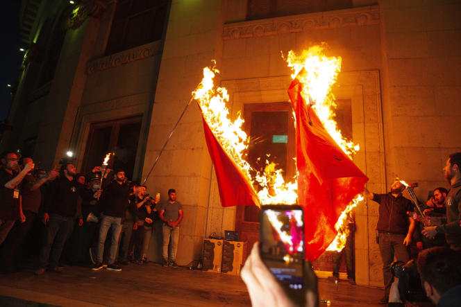 Protesters burn Turkish flags during the 106th anniversary of the Armenian Genocide, in Yerevan, Armenia, on April 24.