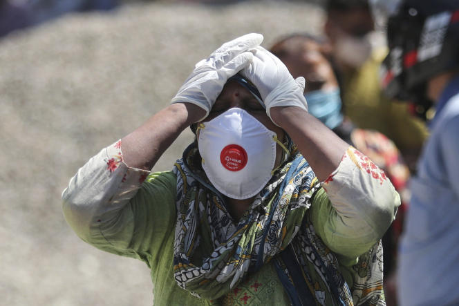 A woman mourns the death of a loved one in Jammu, India, on Sunday, April 25th.
