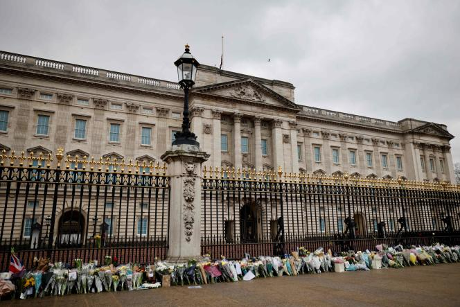 Flowers in honor of Prince Philip, Duke of Edinburgh, outside Buckingham Palace in London on April 10, 2021, the day after he passed away at the age of 99.
