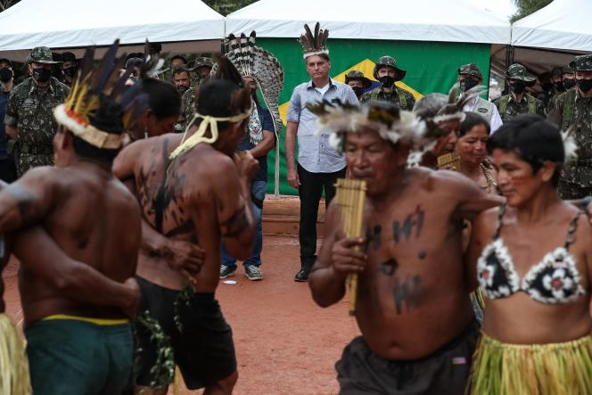 Brazilian President Jair Bolsonaro observes an indigenous celebration with the opening of a bridge in São Gabriel da Cachoeira, Manaus State, Brazil on May 27, 2021.