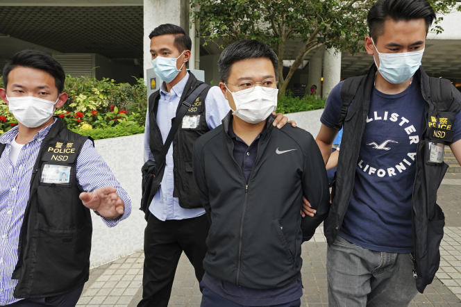 Ryan Lu, second from right, editor, was arrested