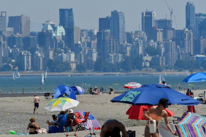 Canadians looking to escape the heat wave come to cool off on the beach in Vancouver, British Columbia, on June 27, 2021.