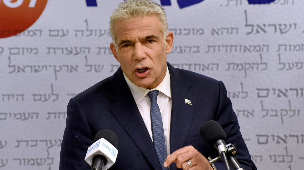 Yair Lapid says he has combined votes to form a national unity government