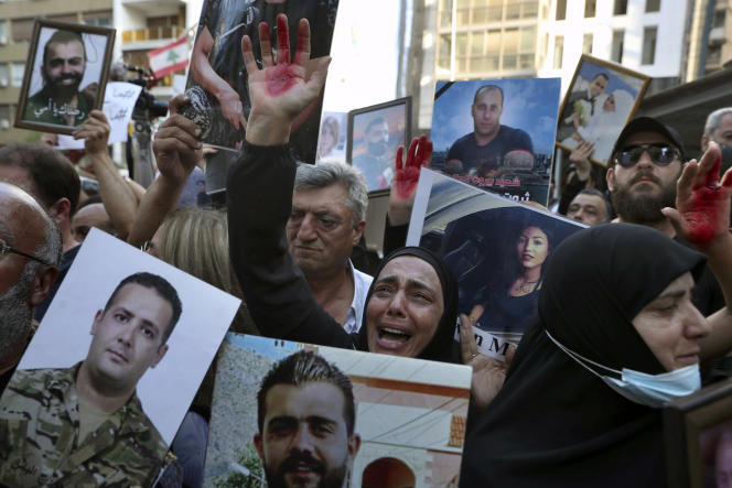 Relatives of blast victims demonstrate in front of the entrance to the home of the interim interior minister, July 13, 2021 in Beirut.