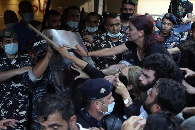 Relatives of Beirut harbor explosion victims oppose police guarding the entrance to the interim interior minister's home on July 13, 2021.