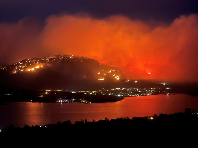 A wildfire, seen from Highway 3 near Osoyoos Township, British Columbia, Canada, July 20, 2021.