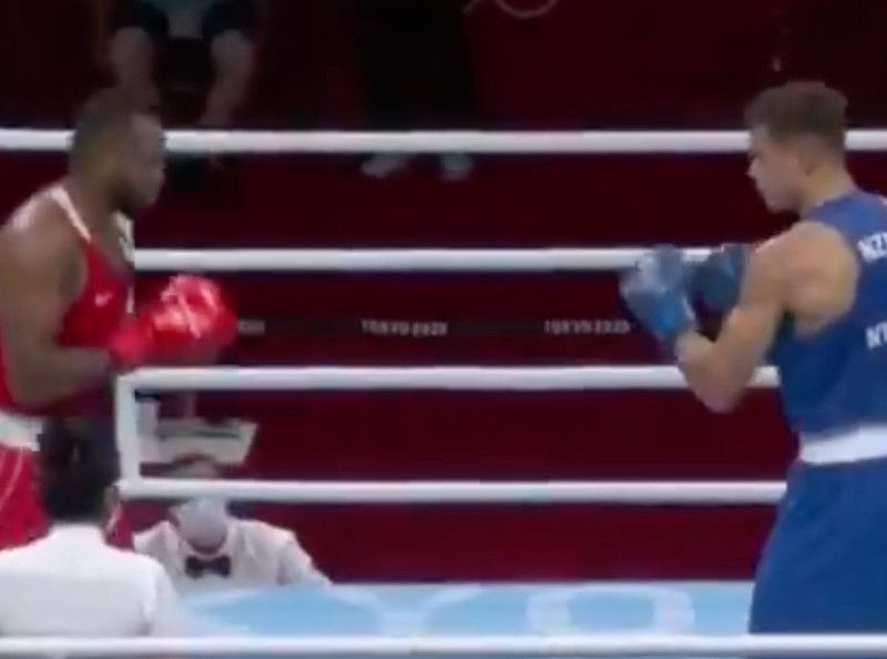abnormal!  A boxer tries to bite his opponent's ear during a fight