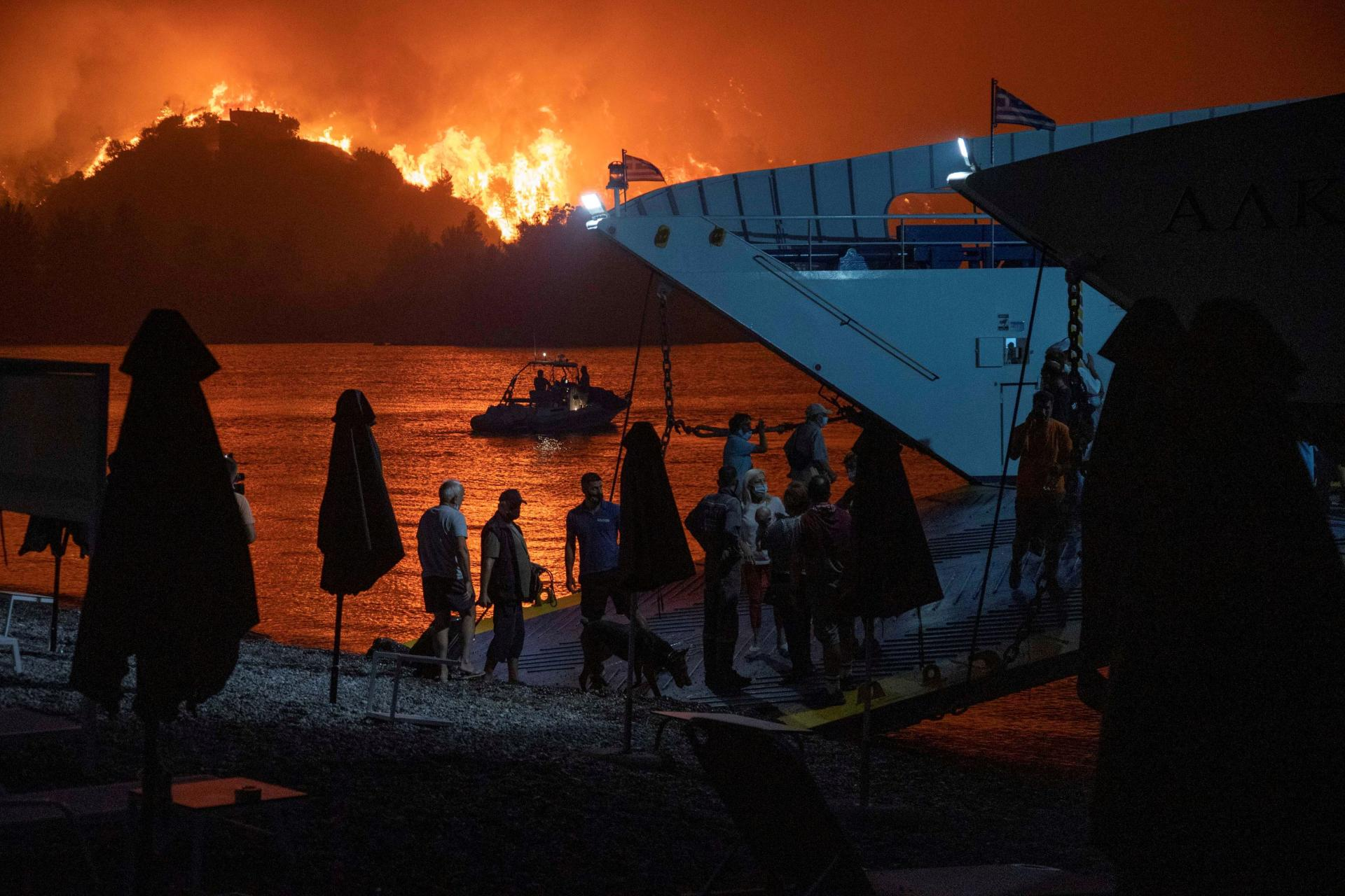 Residents of Limni, on the island of Evia, were evacuated by ferry on August 6, 2021.