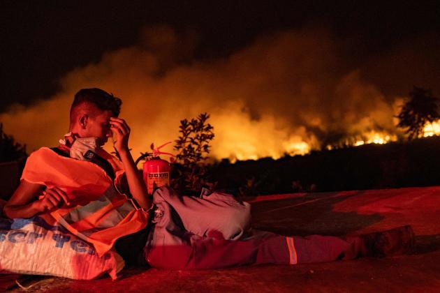 A volunteer rests in Akyaka, Mugla Province, Turkey on August 6, 2021.