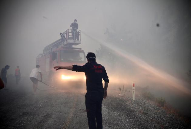 Also in Turkey, forest fires broke out at the beginning of August.  Here, firefighters battle a blaze in Akakuka, Mugla Province on August 6, 2021.