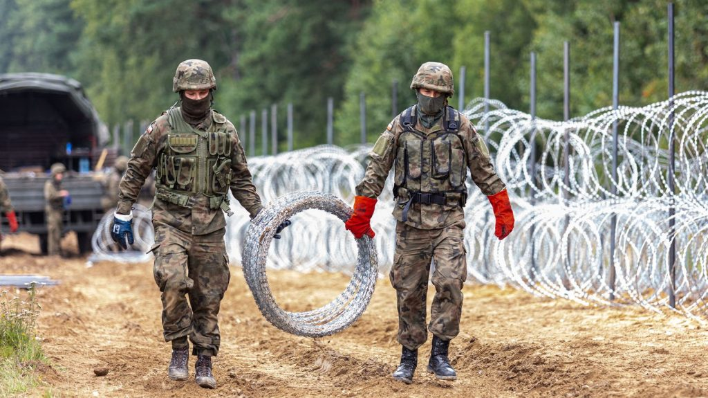 Poland sends thousands of text messages to migrants at its border with Belarus