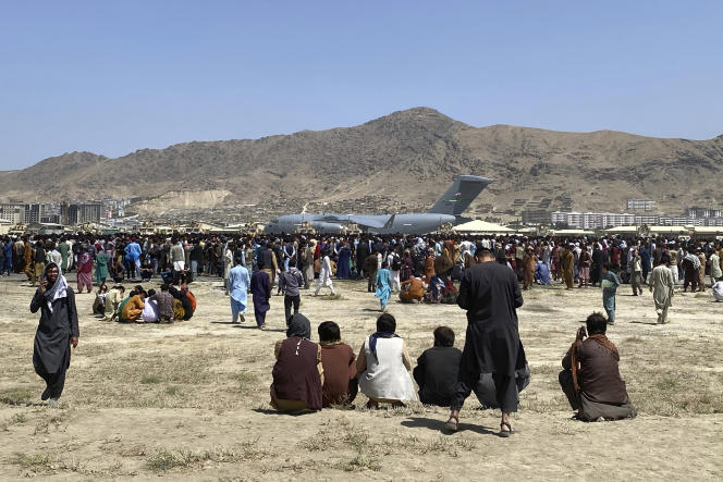 Hundreds of Afghans near the runways at Kabul Airport on August 16, 2021.