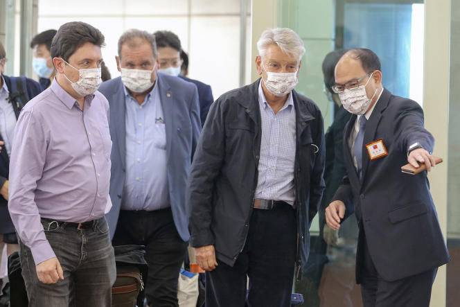French Senator Alain Richard (second from right) upon his arrival at Taiwan Taoyuan International Airport on October 6, 2021.